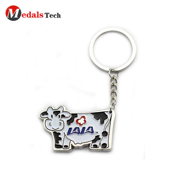 Wholesale cute cow shaped engraved logo souvenir metal keychain
