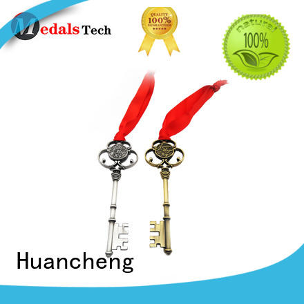Huancheng Brand shiny promotional souvenir home keychain metal logo