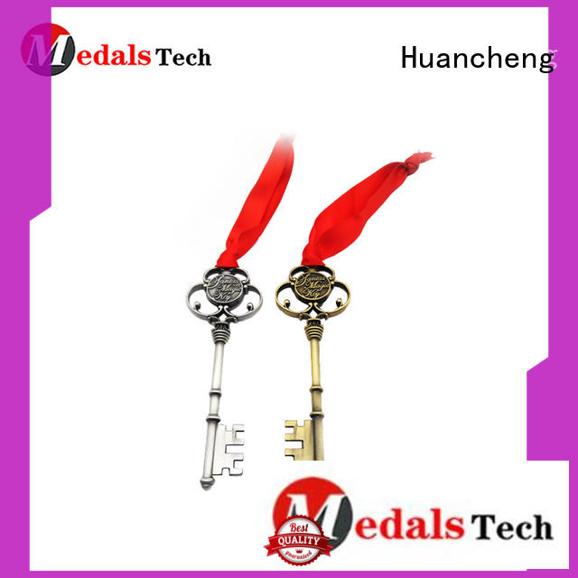 shiny silver metal logo Huancheng Brand name keychains supplier